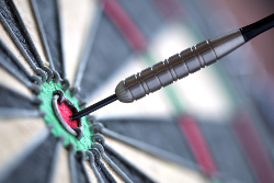 bigstock-Dart-in-bulls-eye-of-dartboard-16555100